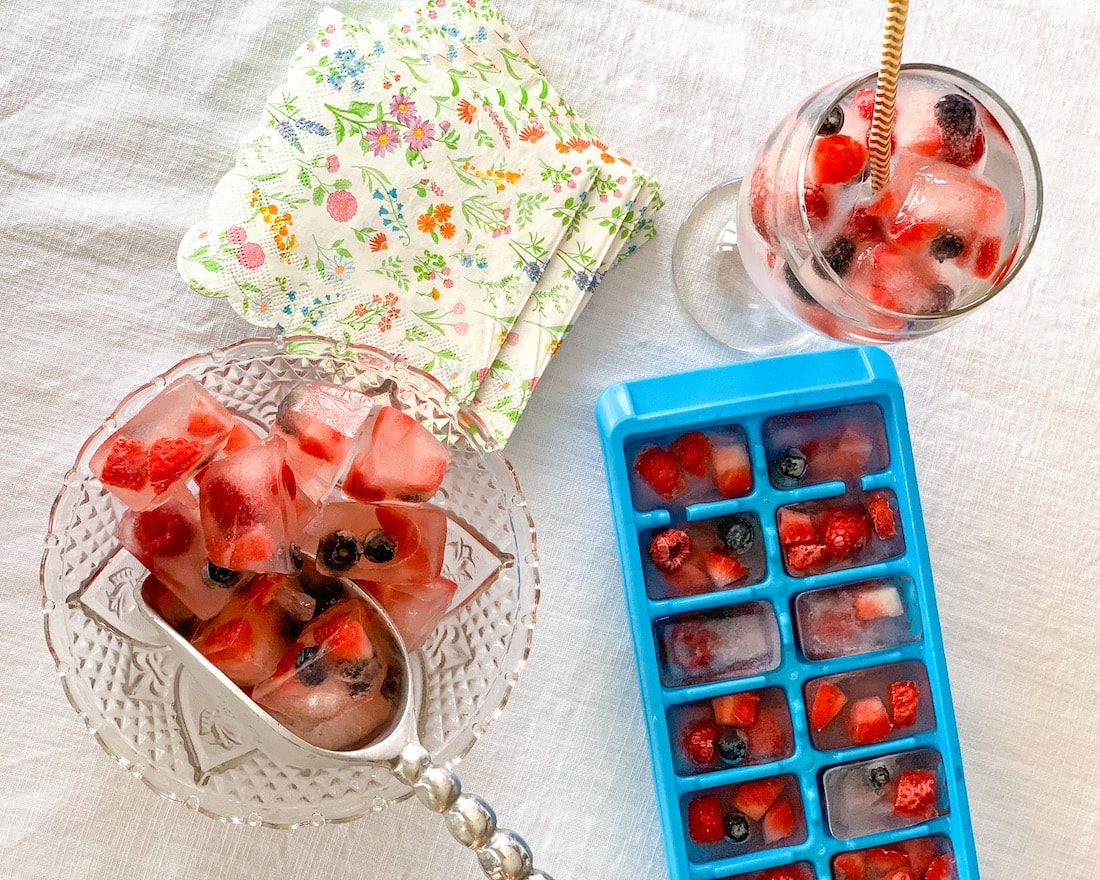 Fruit ice cubes with strawberries, blueberries and raspberries