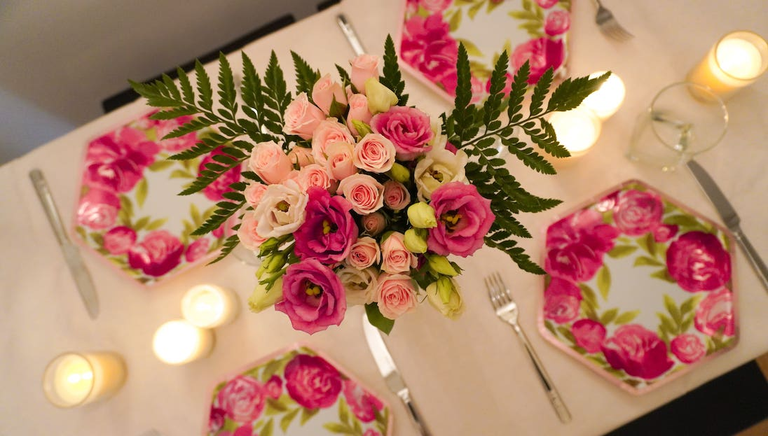 Mother's Day Table with pink floral plates and pink flower arrangement- all under $30